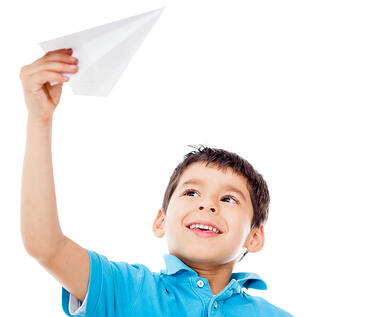 Boy holding a paper airplane - isolated over a white background